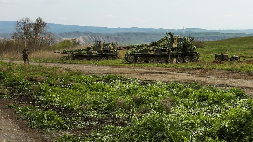 Nagorno-Karabakh army self-propelled artillery vehicles stand on positions in Nagorno-Karabakh, Azerbaijan, Tuesday, April 5, 2016. Azerbaijan forces and separatist forces in Nagorno-Karabakh agreed on a cease-fire Tuesday following three days of the heaviest fighting in the region since 1994, the Azeri defense ministry announced. (Vahan Stepanyan/PAN Photo via AP)