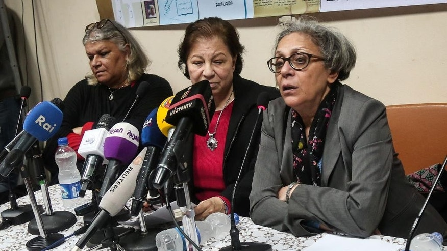 FILE - In this Sunday, Feb. 21, 2016 file photo, Aida Seif el-Dawla, Suzan Fayyad, center, and Magda Adly, right, co-founder of El Nadeem Center for Rehabilitation of Victims of Violence, hold a press conference in Cairo. For more than 20 years, a team of psychiatrists housed in a 100-year-old building down a quiet alley in downtown Cairo have been providing a unique service in Egypt: Therapy for victims of torture. Now authorities are trying to shut down the El Nadeem Center. (AP Photo/Mohamed el Raai, File)