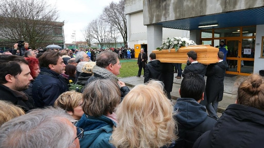 FILE - In this Friday, Feb. 12, 2016 file photo, the coffin of Giulio Regeni arrives at the church for his funeral service in Fiumicello, Northern Italy. Egypt denies its security services were behind the killing of  Regeni. Late last month, the Interior Ministry announced it had killed members of a gang suspected of being behind his death. But that claim was largely dismissed in Italy, where many in the media accuse Egypt of a cover-up. Rome is demanding Cairo come clean and present detailed investigation results. (AP Photo/Paolo Giovannini, File)