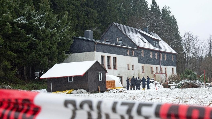 "FILE -  In this Nov. 30, 2013  file picture police investigate the area of crime around a house near Reichenau,, south of Dresden, eastern Germany. The Federal Court of Justice in Leipzig on Wednesday April 6, 2016 did not immediately provide details on its ruling overturning last year's Dresden state court verdict against Detlev G., the dpa news agency reported.  The police officer is currently serving an 8 ½ year prison sentence after being convicted of killing a 59-year-old businessman from Hannover in November 2013 ""to fulfill his sexual desires.""   (AP Photo/Jens Meyer,file)"