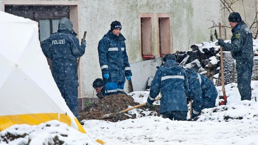 "FILE -  In this Nov. 30, 2013  file picture police investigate the area   around a house near Reichenau,, south of Dresden, eastern Germany. The Federal Court of Justice in Leipzig on Wednesday April 6, 2016 did not immediately provide details on its ruling overturning last year's Dresden state court verdict against Detlev G., the dpa news agency reported.  The police officer is currently serving an 8 ½ year prison sentence after being convicted of killing a 59-year-old businessman from Hannover in November 2013 ""to fulfill his sexual desires.""   (AP Photo/Jens Meyer,file)"