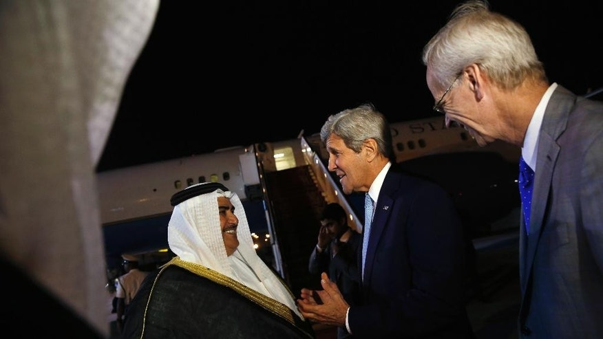 Bahrain's Foreign Minister Khalid bin Ahmed Al Khalifa, left, and U.S. Ambassador to Bahrain William Roebuck, right, greets U.S. Secretary of State John Kerry, second right, as he arrives aboard his plane at Bahrain International Airport in Manama, Bahrain April 6, 2016. (Jonathan Ernst/Pool via AP)