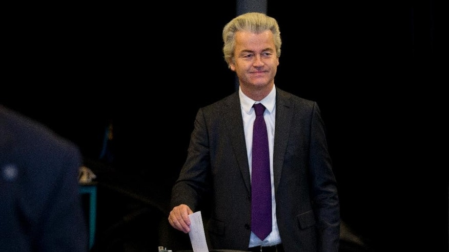 Firebrand Dutch lawmaker Geert Wilders casts his vote in a non-binding referendum on the EU-Ukraine association agreement in The Hague, Netherlands, Wednesday, April 6, 2016. The vote is seen by opponents of the 28-nation EU bloc as an opportunity to express their anger at what they consider unwanted expansionism and a lack of democratic rights for EU citizens.(AP Photo/Peter Dejong)