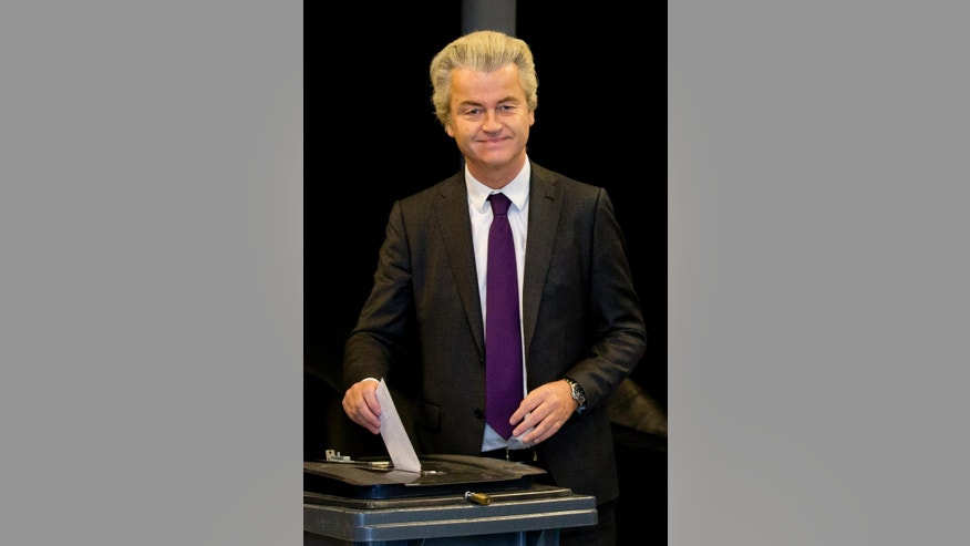 Firebrand Dutch lawmaker Geert Wilders casts his vote in a non-binding referendum on the EU-Ukraine association agreement in The Hague, Netherlands, Wednesday, April 6, 2016. The vote is seen by opponents of the 28-nation EU bloc as an opportunity to express their anger at what they consider unwanted expansionism and a lack of democratic rights for EU citizens, three months before British citizens decide in their own referendum whether to leave the EU altogether. (AP Photo/Peter Dejong)