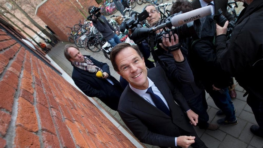 Dutch Prime Minister Mark Rutte leaves the polling station after casting his vote in a non-binding referendum on the EU-Ukraine association agreement in The Hague, Netherlands, Wednesday, April 6, 2016. The vote is seen by opponents of the 28-nation EU bloc as an opportunity to express their anger at what they consider unwanted expansionism and a lack of democratic rights for EU citizens, three months before British citizens decide in their own referendum whether to leave the EU altogether.(AP Photo/Peter Dejong)