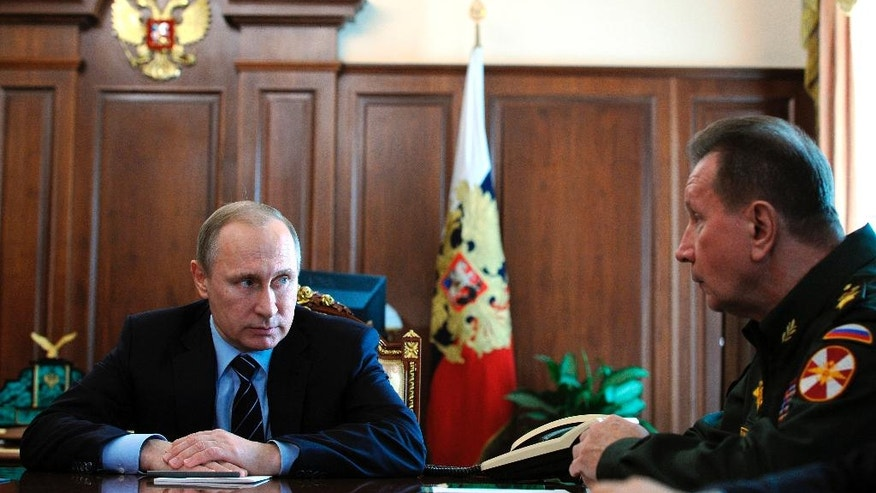 Russian President Vladimir Putin, left, and Commander-in-Chief of the Interior Ministry troops Viktor Zolotov attend a meeting in the Kremlin in Moscow, Russia, Tuesday, April 5, 2016. (Mikhail Klimentyev/Sputnik, Kremlin Pool Photo via AP)