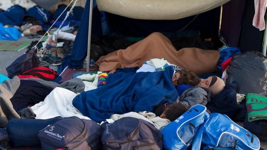 Migrants and refugees sleep at the port of the Greek island of Chios, Wednesday, April 6, 2016. On Monday, 202 migrants from 11 countries were sent back to Turkey from the Greek islands of Lesbos and Chios. The same day, 155 migrants were caught on the Aegean by the Turkish coast guard. (AP Photo/Petros Giannakouris)