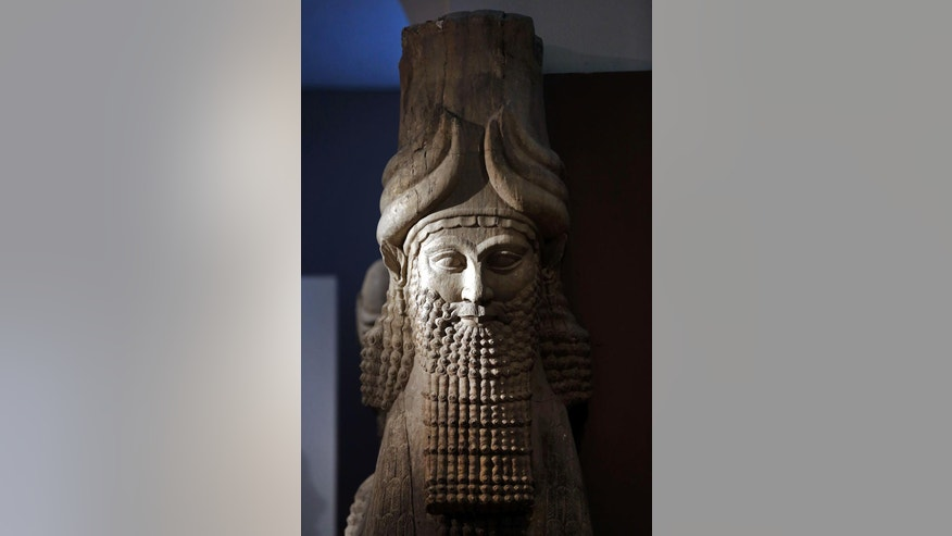 FILE- This file photo taken on Monday, Sept. 15, 2014, shows a detail of a statue of Lamassu, the great winged bull from the Assyrian period displayed at the Iraq National Museum in Baghdad. After the destruction wreaked on archaeological sites by Islamic State group, the collections at the Iraq's National Museum in Baghdad have become even more important. It's now one of the places you can find relics from ancient cities that fell into the extremists' hands. As many as 4,000 archaeological sites are still under the domination of IS and around 100 sites have been destroyed, according to Iraqi Culture Minister Firyad Rwandzi. (AP Photo/Hadi Mizban, File)