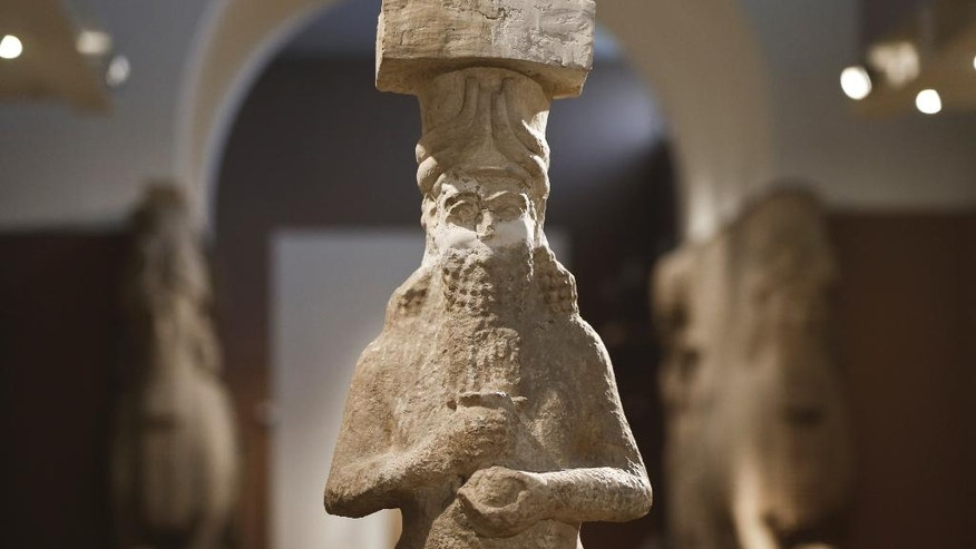 In this Sunday, March 13, 2016 photo, a detail of a figure at the Assyrian Hall of the Iraq National Museum Baghdad. Assyria was a civilization located near the modern-day city of Mosul, now held by the Islamic State group, who published videos online showing the destruction of key Assyrian sites Nimrud and Hatra along with many other religious and cultural sites.(AP Photo/Maya Alleruzzo)