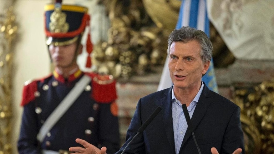 Argentina's President Mauricio Macri gives a statement at the government house in Buenos Aires, Argentina, Thursday, April 7, 2016. An Argentine prosecutor on Thursday asked for an investigation into President Mauricio Macri's role in offshore companies, adding to the global fallout from a massive leak of documents from a Panama law firm. (AP Photo/Natacha Pisarenko)