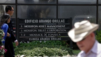 People walk past the Arango Orillac Building which lists the Mossack Fonseca law firm in Panama City, Tuesday, April 5, 2016. Millions of confidential documents were leaked from the Panama-based law firm, revealing details of how some of the globe's richest people funnel their assets into secretive shell companies set up here and in other lightly regulated jurisdictions. (AP Photo/Arnulfo Franco)