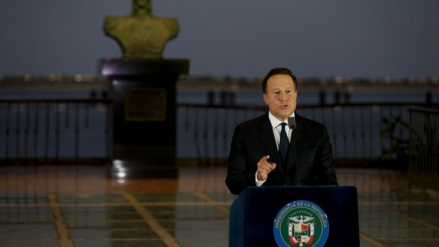 "With a bust of Latin America's independence hero Simon Bolivar in the background, Panama's President Juan Carlos Varela gives a televised statement to the nation, in Panama City, Wednesday, April 6, 2016. Varela spoke about the millions of confidential documents that were leaked from a Panama-based law firm, coined the ""panama papers,"" revealing details of how some of the globe's richest people funnel their assets into secretive shell companies set up in Panama and in other lightly regulated jurisdictions. (AP Photo/Arnulfo Franco)"