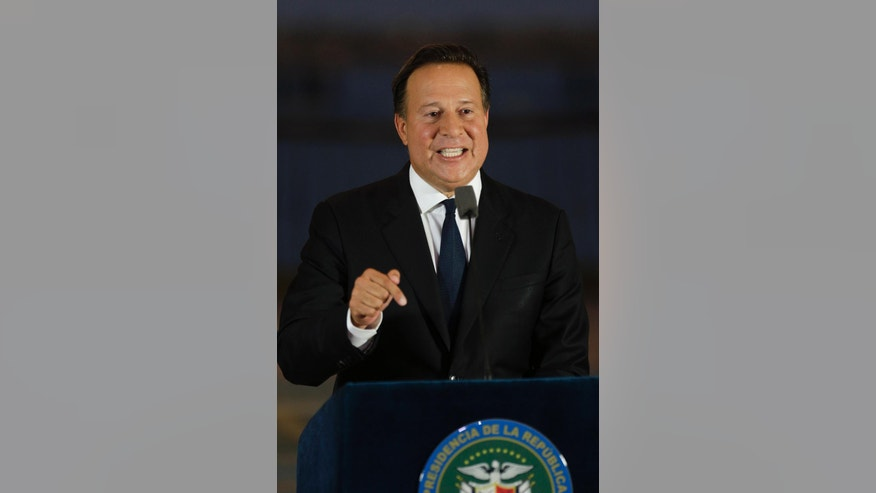 "Panama's President Juan Carlos Varela gives a televised statement to the nation, in Panama City, Wednesday, April 6, 2016. Varela spoke about the millions of confidential documents that were leaked from a Panama-based law firm, coined the ""panama papers,"" revealing details of how some of the globe's richest people funnel their assets into secretive shell companies set up in Panama and in other lightly regulated jurisdictions. (AP Photo/Arnulfo Franco)"