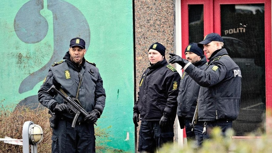 "Danish police are seen after searching an apartment in Ishoej, Denmark, Thursday, April 7, 2016. Four people have been arrested in greater Copenhagen, suspected of having ""enlisted"" the Islamic State group with the intention to commit terror, police said Thursday. All four suspects, arrested Thursday in Copenhagen and its suburbs, are suspected of violating Denmark terror laws by joining a terrorist organization. (Joachim Adrian/POLFOTO via AP) DENMARK OUT"