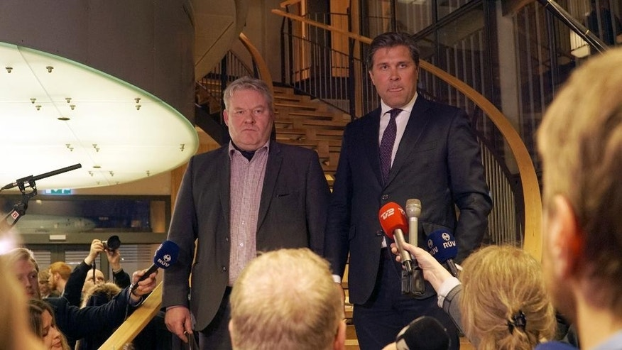 Iceland's Sigurdur Ingi Johannsson, left, deputy chairman of the Progressive Party, and Bjarni Benediktsson, leader of the Independence Party attend a press conference at parliament in Reykjavik, Iceland Wednesday, April 6, 2016. Johannsson said Wednesday he will seek the president's approval to become the country's next prime minister after the previous leader resigned because of revelations he had offshore accounts. Progressive Party is in a coalition government with the Independence Party. (AP Photo/David Keyton)