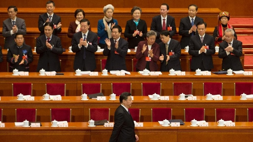In this March 5, 2016 photo, Chinese President Xi Jinping arrives for the opening session of the annual National People's Congress in Beijing's Great Hall of the People. For graft-busting Chinese Communist Party leader Xi Jinping, recent overseas media reports showing his brother-in-law and relatives of two other members of the party's elite inner circle owned offshore companies, often referred to as tax havens, might have been highly damaging. Instead, Xi will likely emerge unscathed as a result of his personal hold on political power, controls over free speech and the media, and a sense both among the public and potential rivals that all leading families are tainted to some degree, analysts say. (AP Photo/Ng Han Guan)
