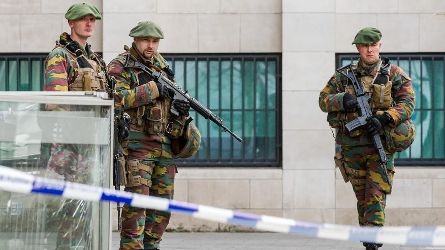 "Soldiers stand guard as terror suspect Salah Abdeslam's case appears in court at a justice building in Brussels on Thursday, April 7, 2016.  The lawyer for Paris attacks suspect Salah Abdeslam said Thursday from Brussels that it would take ""some weeks"" before his client would be extradited to France.  (AP Photo/Geert Vanden Wijngaert)"