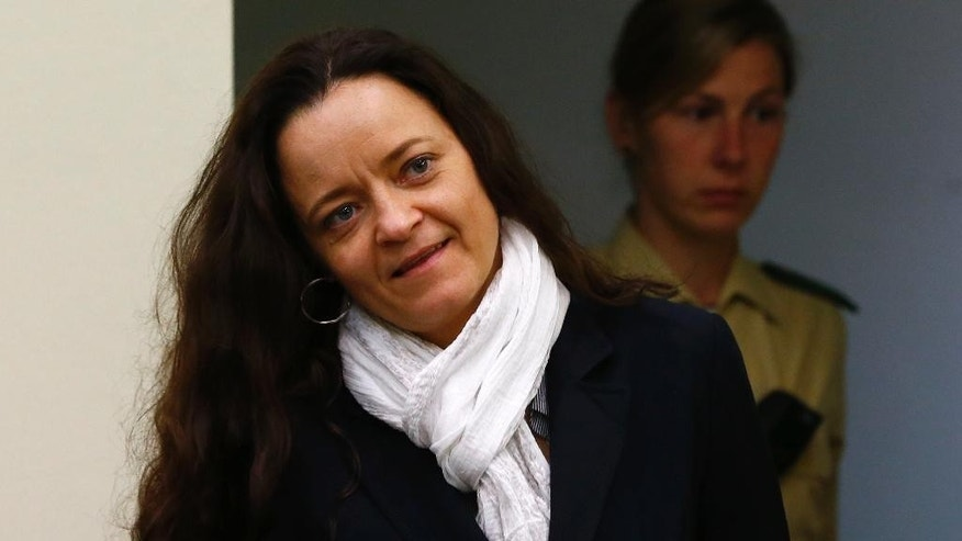 Terror suspect Beate Zschaepe arrives at the court room in Munich, Germany, Tuesday, April 5, 2016. Zschaepe has been on trial since May 2013 as an alleged accomplice in a series of racially motivated murders by a neo-Nazi terrorist cell of the so-called National Socialist Underground (NSU) across Germany. (AP Photo/Matthias Schrader)