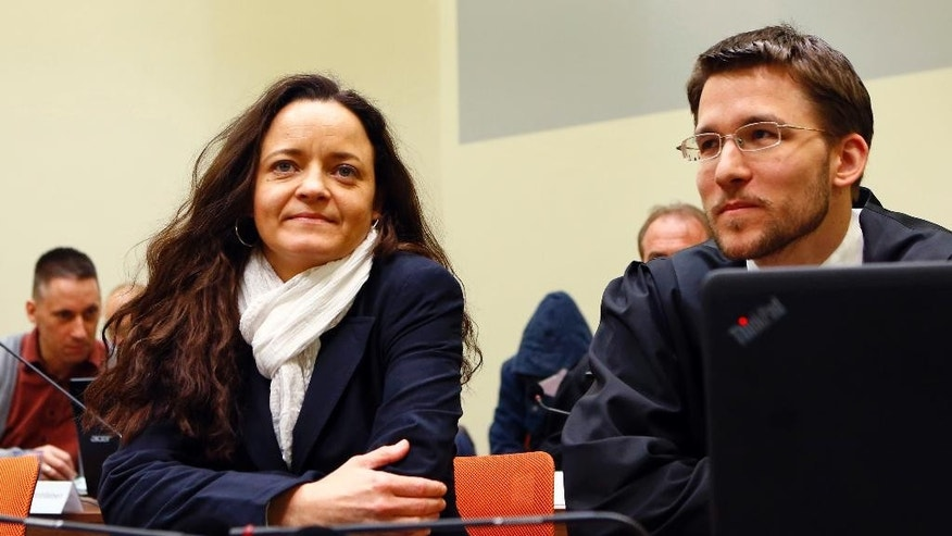 Terror suspect Beate Zschaepe sits in the court room besides her lawyer Mathias Grasel, right, in Munich, Germany, Tuesday, April 5, 2016. Zschaepe has been on trial since May 2013 as an alleged accomplice in a series of racially motivated murders by a neo-Nazi terrorist cell of the so-called National Socialist Underground (NSU) across Germany. (AP Photo/Matthias Schrader)