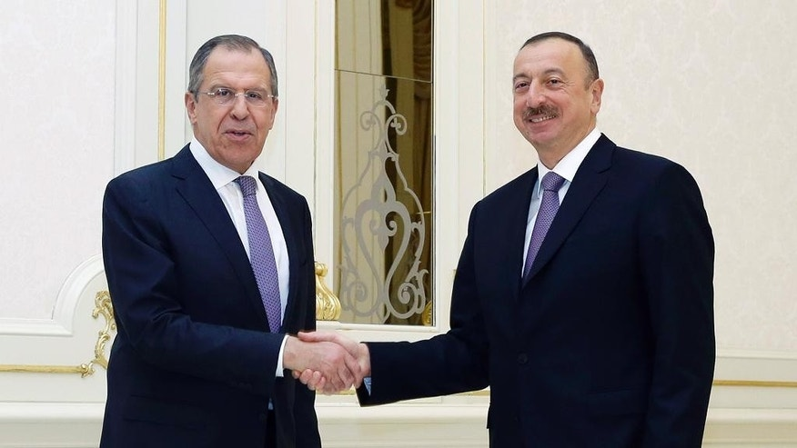 Azerbaijan President Ilham Aliyev, right, shakes hands with Russian Foreign Minister Sergey Lavrov, prior their talks in Baku, Azerbaijan, Wednesday, April 6, 2016. Sergey Lavrov met in Baku with Azerbaijani President Ilham Aliyev Wednesday, offering to help ensure that the truce will last and to contribute to a political settlement. (AP Photo)