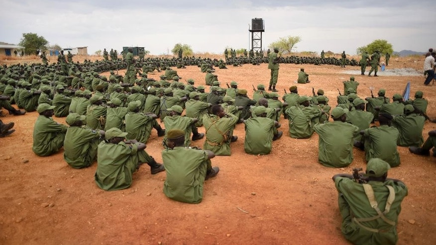 South Sudanese rebel soldiers listen to instructions at a military camp in the capital Juba, South Sudan Thursday, April 7, 2016. South Sudan's rebels have set up camp at two designated sites in the capital as part of the process to secure the city for their leader Riek Machar's return later this month, and eventually reintegrate into the split army, after over two years of war. (AP Photo/Jason Patinkin)