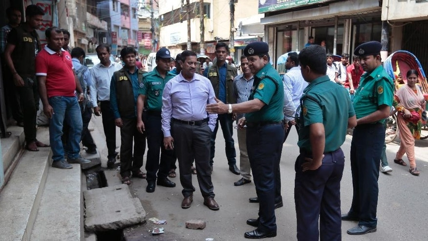 Bangladeshi police officers investigate at the spot where three motorcycle-riding assailants hacked student activist Nazimuddin Samad to death while walking with a friend, in Dhaka, Bangladesh, Thursday, April 7, 2016. Police suspect 28-year-old Samad was targeted for his outspoken atheism in the Muslim majority country and for supporting a 2013 movement demanding capital punishment for war crimes involving the country's independence war against Pakistan in 1971, according to Dhaka Metropolitan Police Assistant Commissioner Nurul Amin. ( AP Photo)