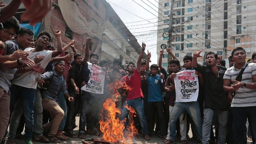 Bangladeshi students protest seeking arrest of three motorcycle-riding assailants who hacked student activist Nazimuddin Samad to death as he walked with a friend, in Dhaka, Bangladesh, Thursday, April 7, 2016. Police suspect 28-year-old Samad was targeted for his outspoken atheism in the Muslim majority country and for supporting a 2013 movement demanding capital punishment for war crimes involving the country's independence war against Pakistan in 1971, according to Dhaka Metropolitan Police Assistant Commissioner Nurul Amin. ( AP Photo)