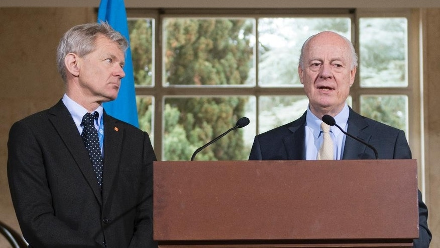 Jan Egeland, left, Senior Advisor to the United Nations Special Envoy for Syria, Staffan de Mistura, right, UN Special Envoy for Syria, inform about the International Syria Support Group's Humanitarian Access Task Force update at the European headquarters of the United Nations in Geneva, Switzerland, Thursday, April 7, 2016. (Martial Trezzini/Keystone via AP)