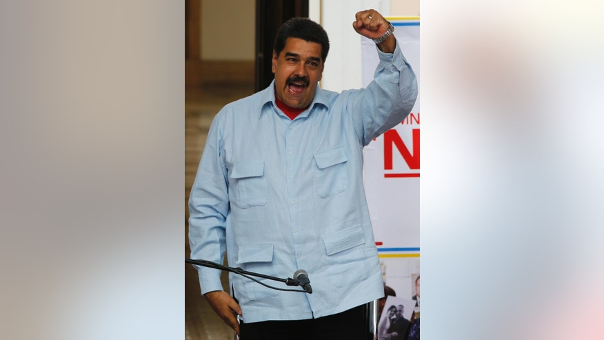 Venezuela's President Nicolas Maduro speaks during a demonstration, at Miraflores Presidential Palace in Caracas, Venezuela, Thursday, April 7, 2016. Groups allied to Venezuela's socialist administration marched to protest an amnesty law passed by the opposition controlled congress calling for release of those it deems to be political detainees. (AP Photo/Ariana Cubillos)
