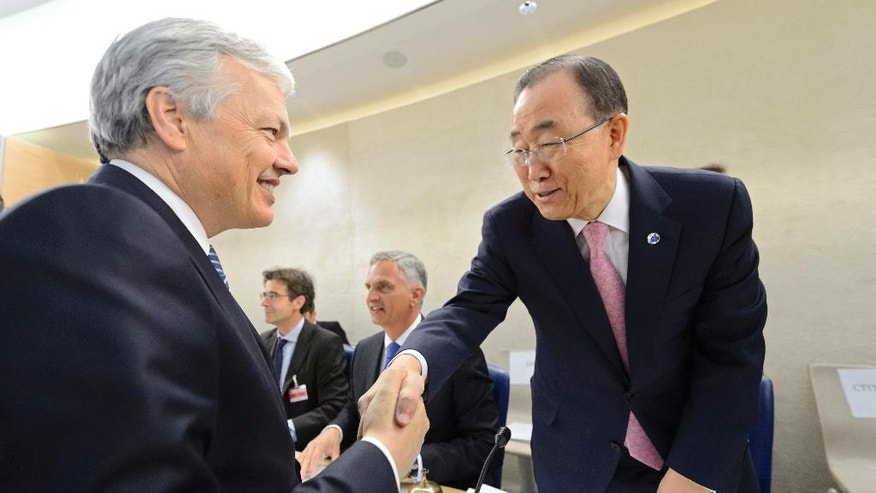 United Nations Secretary General Ban Ki-Moon, right, shakes hands with Belgian Foreign Minister Didier Reynders, left, at the Geneva Conference on Preventing Violent Extremism at the European headquarters of the United Nations in Geneva, Switzerland, Friday, April 8, 2016. (Martial Trezzini/Keystone via AP)