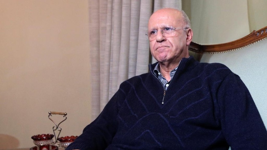 In this Thursday, Jan. 14, 2016 photo, former Lebanese information minister Michel Samaha sits at his home in Beirut, Lebanon, after being released on a $100,000 bail, pending retrial. Lebanon's Military Court of Cassation on Friday, April. 8, 2016 sentenced Samaha to 13 years in jail after he was convicted of terrorism charges. (AP Photo)