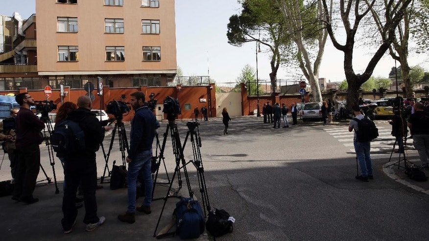 Media wait for the arrival of Egypitian authorities and police officers at a police station to meet Italian prosecutors over the slaying of Italian graduate student Giulio Regeni, in Rome, Thursday, April 7, 2016. Regeni, 28, an Italian doctoral student disappeared in Cairo on Jan. 25, the anniversary of Egypt's 2011 uprising, a day when security forces were on high alert and on the streets in force to prevent any demonstrations or protests. His body, stabbed repeatedly and exhibiting cigarette burns and other signs of torture, was reported found on Feb. 3. (AP Photo/Andrew Medichini)