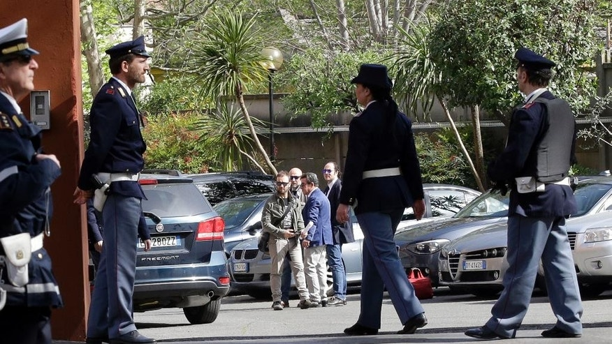 Unidentified Egyptian authorities and police officers arrive in cars at a police station to meet Italian prosecutors over the slaying of Italian graduate student Giulio Regeni, in Rome, Thursday, April 7, 2016. Regeni, 28, an Italian doctoral student disappeared in Cairo on Jan. 25, the anniversary of Egypt's 2011 uprising, a day when security forces were on high alert and on the streets in force to prevent any demonstrations or protests. His body, stabbed repeatedly and exhibiting cigarette burns and other signs of torture, was reported found on Feb. 3. (AP Photo/Andrew Medichini)