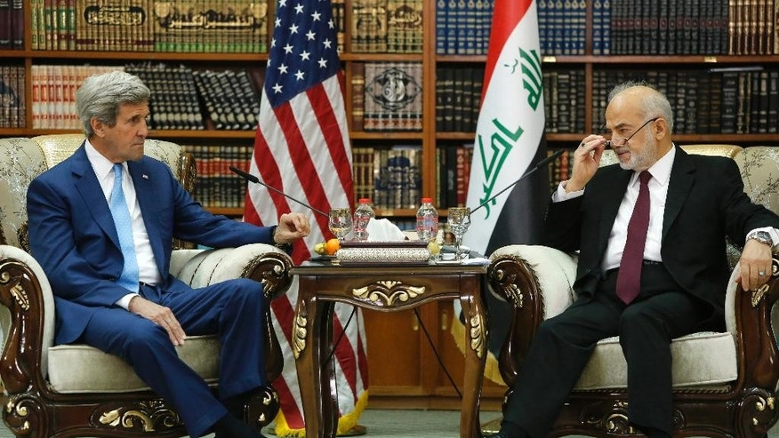 Iraq Foreign Minister Ibrahim al-Jaafari, right, receives Secretary of State John Kerry in the library at the foreign minister's villa in Baghdad, Friday, April 8, 2016. (Jonathan Ernst/Pool Photo via AP)