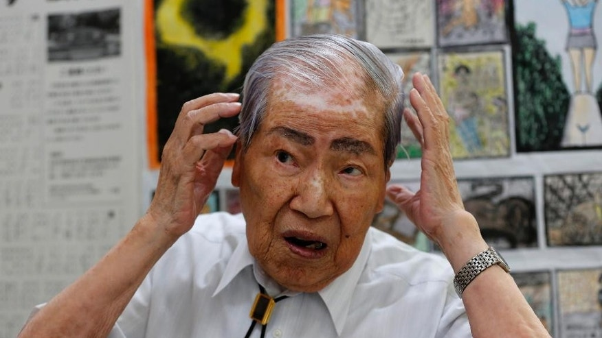FILE - In this Wednesday, Aug. 28, 2013 file photo, Japan Confederation of A-and H-Bomb Sufferers Organizations Co-chairperson Sunao Tsuboi speaks during an interview at his office in Hiroshima, western Japan. Secretary of State John Kerry will become the highest-ranking American government official to visit Hiroshima, where 140,000 Japanese died from the first of two atomic bombs dropped by his country in the closing days of World War II more than 70 years ago. (AP Photo/Shizuo Kambayashi, File)