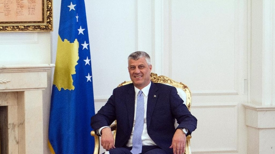 Kosovo's new president Hashim Thaci sits after a hand over ceremony in Kosovo capital Pristina on Thursday. April 7, 2016. Thaci, 47, who replaces Atifete Jahjaga, was elected in Parliament on Feb. 26 in the absence of nearly all opposition lawmakers who earlier tried to disrupt the voting with tear gas. (AP Photo/Visar Kryeziu)