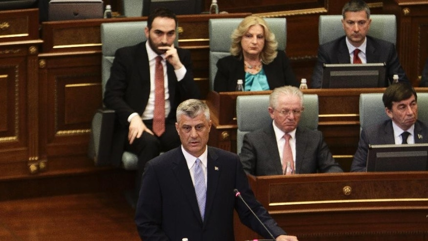Kosovo's new president Hashim Thaci addresses lawmakers after he assumed his post in a swearing-in ceremony, at the Parliament that the opposition boycotted in Kosovo's capital Pristina on Thursday. Apr. 7, 2016. Thaci, 47, who replaces Atifete Jahjaga, was elected in Parliament on Feb. 26 in the absence of nearly all opposition lawmakers who earlier tried to disrupt the voting with tear gas. (AP Photo/Visar Kryeziu)