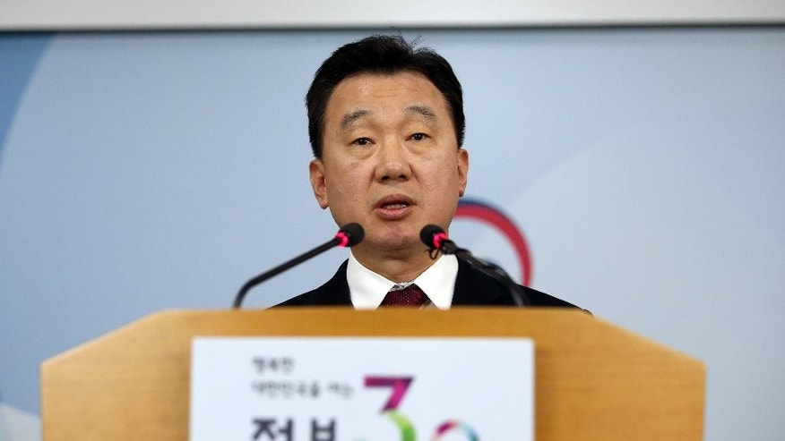 South Korean Unification Ministry spokesman Jeong Joon Hee speaks about North Korean workers' defection to South Korea during a briefing at the government complex in Seoul, South Korea, Friday, April 8, 2016. Jeong said 13 North Koreans working at the same restaurant in a foreign country have defected to the South. This is the first time multiple workers have escaped from the same restaurant. (Shin Jun-hee/Yonhap via AP) KOREA OUT