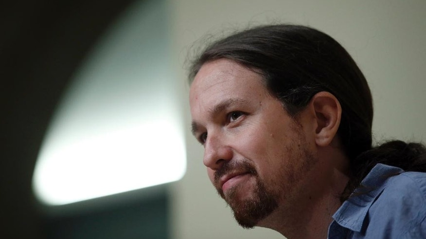 Podemos Party leaders Pablo Iglesias attends a press conference after a meeting with Catalan regional President Carles Puigdemont at the Generalitat Palace in Barcelona, Spain, Friday, April 8, 2016. The leader of Spain's far left Podemos party has announced Friday that party members will vote next week on whether to support or oppose a deal to form a government and end nearly four months of political stalemate.(AP Photo/Manu Fernandez)