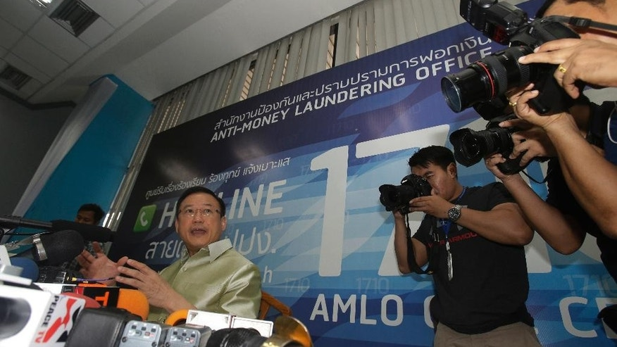 Thailand's Anti-Money Laundering Office Secretary-General Seehanart Prayoonrat talks to reporters during a press conference in Bangkok, Thailand, Friday, April 8, 2016. Authorities in Thailand are investigating 16 citizens with reported ties to offshore companies set up by a Panama-based law firm. Thai politicians and business figures are among those being investigated by the office, but it did not name anyone at the press conference. (AP Photo/Sakchai Lalit)