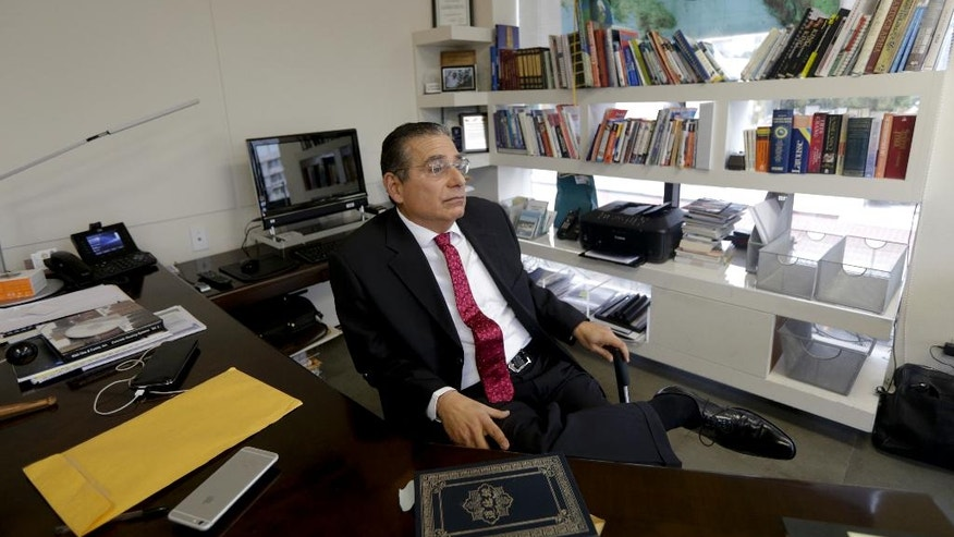 Partner of the Panama-based law firm Mossack Fonseca, Ramon Fonseca sits in his office in during an interview in Panama City, Thursday, April 7, 2016. Fonseca, a co-founder of Mossack Fonseca, one of the world's largest creators of shell companies, said that documents investigated by the ICIJ were authentic and had been obtained illegally by hackers. (AP Photo/Arnulfo Franco)