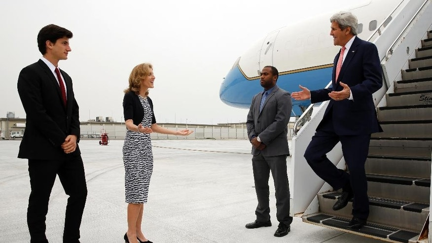 U.S. Ambassador to Japan Caroline Kennedy, second from left, and her son Jack Schlossberg, left, greet Secretary of State John Kerry, right, as he arrives, ahead of G7 foreign minister meetings, at Iwakuni Marine Corps Air Station, Japan, Sunday, April 10, 2016. (Jonathan Ernst/Pool via AP)