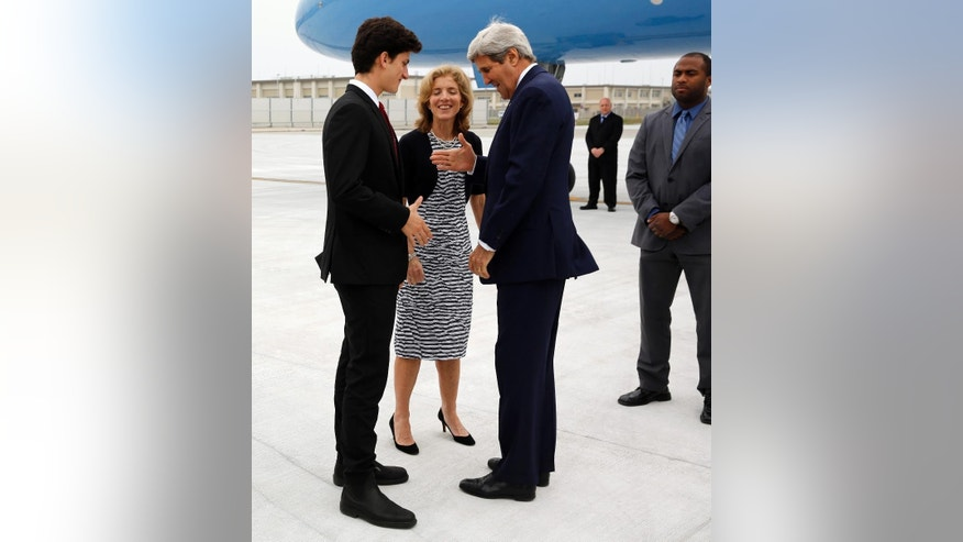 U.S. Ambassador to Japan Caroline Kennedy, center,  and her son Jack Schlossberg, left, greet Secretary of State John Kerry, right, as he arrives, ahead of G7 foreign minister meetings, at Iwakuni Marine Corps Air Station, Japan, Sunday, April 10, 2016. (Jonathan Ernst/Pool via AP)