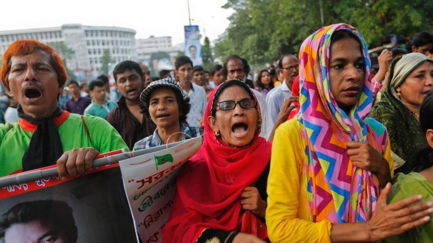 Bangladeshi activists and students shout slogans, demanding arrest of three motorcycle-riding assailants who hacked and shot student activist Nazimuddin Samad to death as he walked with a friend, in Dhaka, Bangladesh, Friday, April 8, 2016. Police suspect 28-year-old Samad was targeted for his outspoken atheism in the Muslim majority country and for supporting a 2013 movement demanding capital punishment for war crimes involving the country's independence war against Pakistan in 1971. (AP Photo)