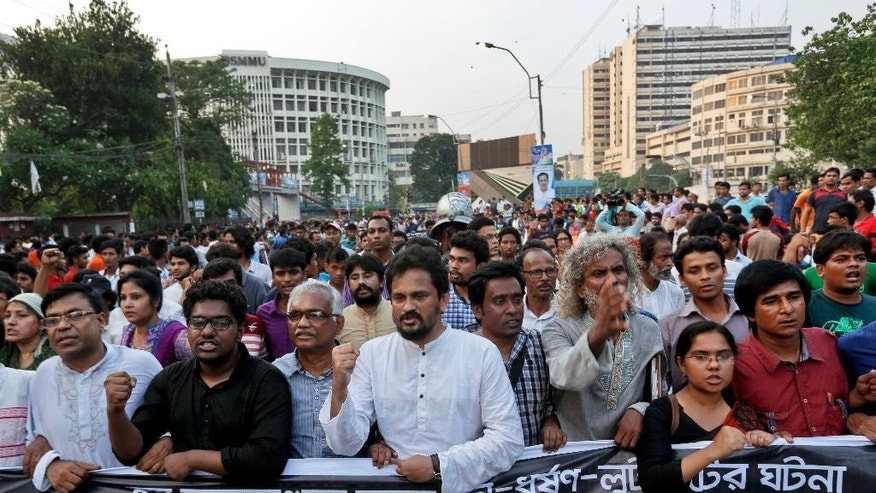 Bangladeshi activists and students shout slogans demanding arrest of three motorcycle-riding assailants who hacked and shot student activist Nazimuddin Samad to death as he walked with a friend, in Dhaka, Bangladesh, Friday, April 8, 2016. Police suspect 28-year-old Samad was targeted for his outspoken atheism in the Muslim majority country and for supporting a 2013 movement demanding capital punishment for war crimes involving the country's independence war against Pakistan in 1971. (AP Photo)