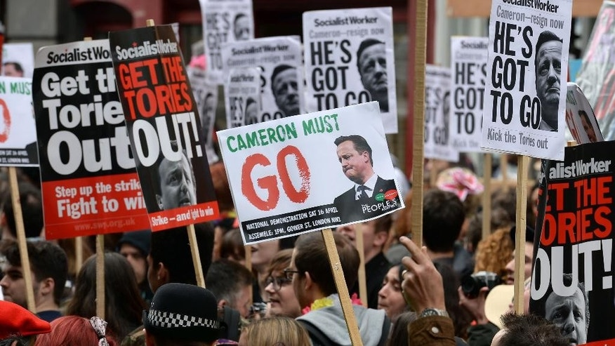 Protesters call for the resignation of Prime Minister David Cameron outside the Conservative party's spring forum in central London, Saturday, April 9, 2016. (John Stillwell/PA via AP) UNITED KINGDOM OUT