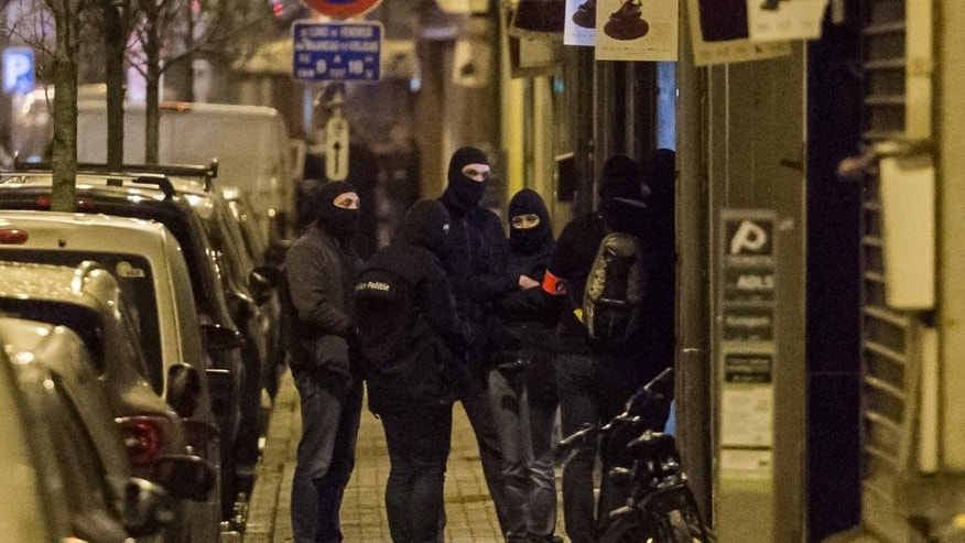 "Police investigate an area where terror suspect Mohamed Abrini was arrested earlier today, in Brussels on Friday April 8, 2016. The federal prosecutor's office confirmed a fugitive suspect in the Nov. 13 Paris attacks was arrested in Belgium on Friday, after a raid Belgian authorities said was linked to the deadly March 22 Brussels bombings. The suspect, Mohamed Abrini, is believed to be the mysterious ""man in the hat"" who escaped the double bombing at Brussels airport, but further investigation is needed to determine Abrini is the third suspect of the airport attack. (AP Photo/Geert Vanden Wijngaert)"