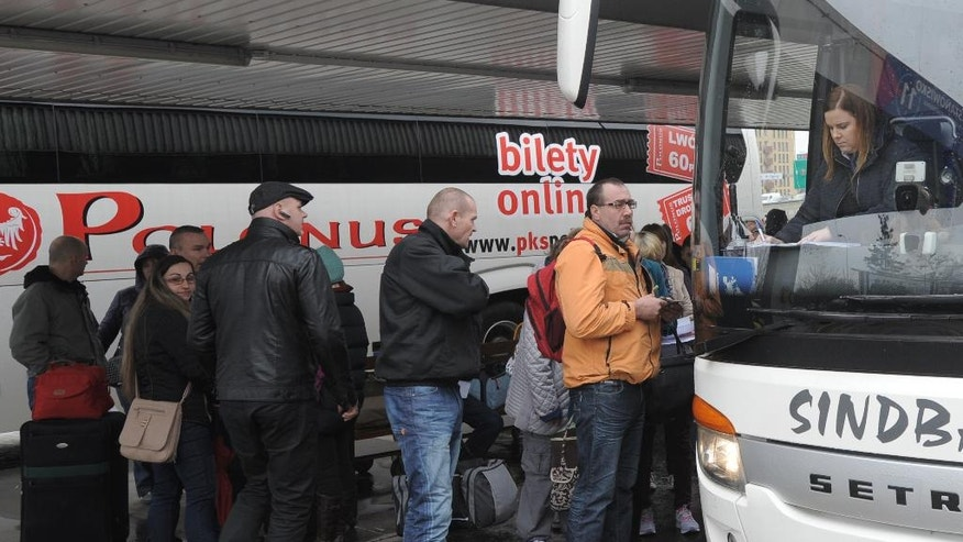 "In this picture taken April 1, 2016, people board a coach to London at a bus station in Warsaw, Poland. Britain's dynamic economy has attracted more people from Poland than any other single EU country, and they worry that they could be among the big losers if British voters opt for ""Brexit"" in the June 23 referendum. (AP Photo/Alik Keplicz)"