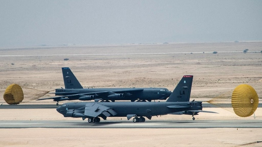U.S. Air Force B-52 Stratofortress aircraft from Barksdale Air Force Base, Louisiana, arrive at Al Udeid Air Base, Qatar, Saturday, April 9, 2016. The U.S. Air Force says it has deployed the bombers to take part in the U.S.-led bombing campaign against the Islamic State group. It is the first time the Cold War-era heavy bombers will be based in the region since the 1991 Gulf War, when they operated from neighboring Saudi Arabia. (Staff Sgt. Corey Hook/U.S. Air Force via AP)