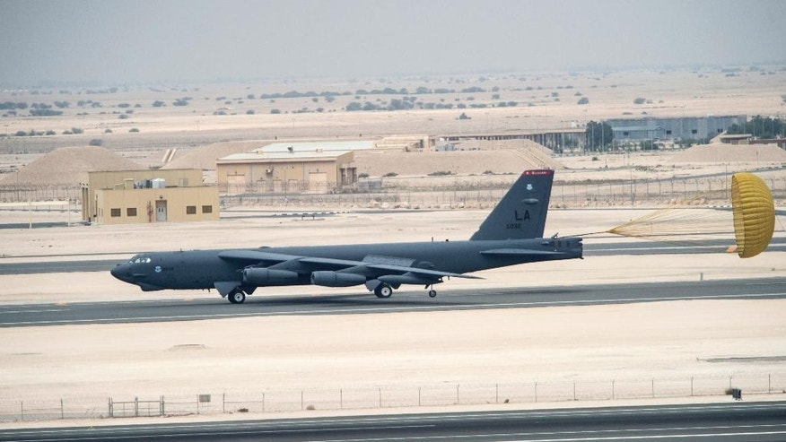 A U.S. Air Force B-52 Stratofortress aircraft from Barksdale Air Force Base, Louisiana, arrive at Al Udeid Air Base, Qatar, Saturday, April 9, 2016. The U.S. Air Force says it has deployed the bombers to take part in the U.S.-led bombing campaign against the Islamic State group. It is the first time the Cold War-era heavy bombers will be based in the region since the 1991 Gulf War, when they operated from neighboring Saudi Arabia. (Staff Sgt. Corey Hook/U.S. Air Force via AP)
